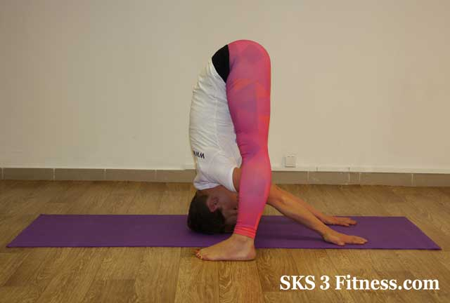 Yoga girl showing Uttanasan variation for experts with high flexibility level.