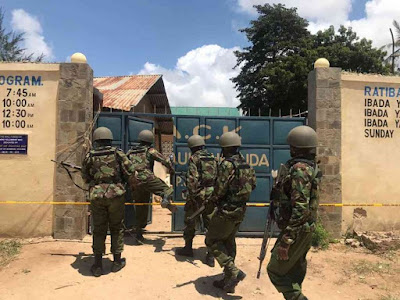 AP officers walking into ACK St Pauls Ukunda church where two police officers were attacked by suspected thugs. Photo/ELKANA JACOB