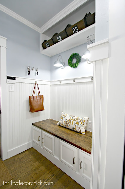 Laundry room turned mud room with white beadboard