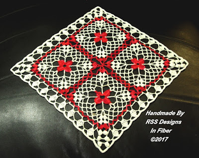 Diamond Display of RSS Designs In Fiber Red Flower in White Lace Square Doily