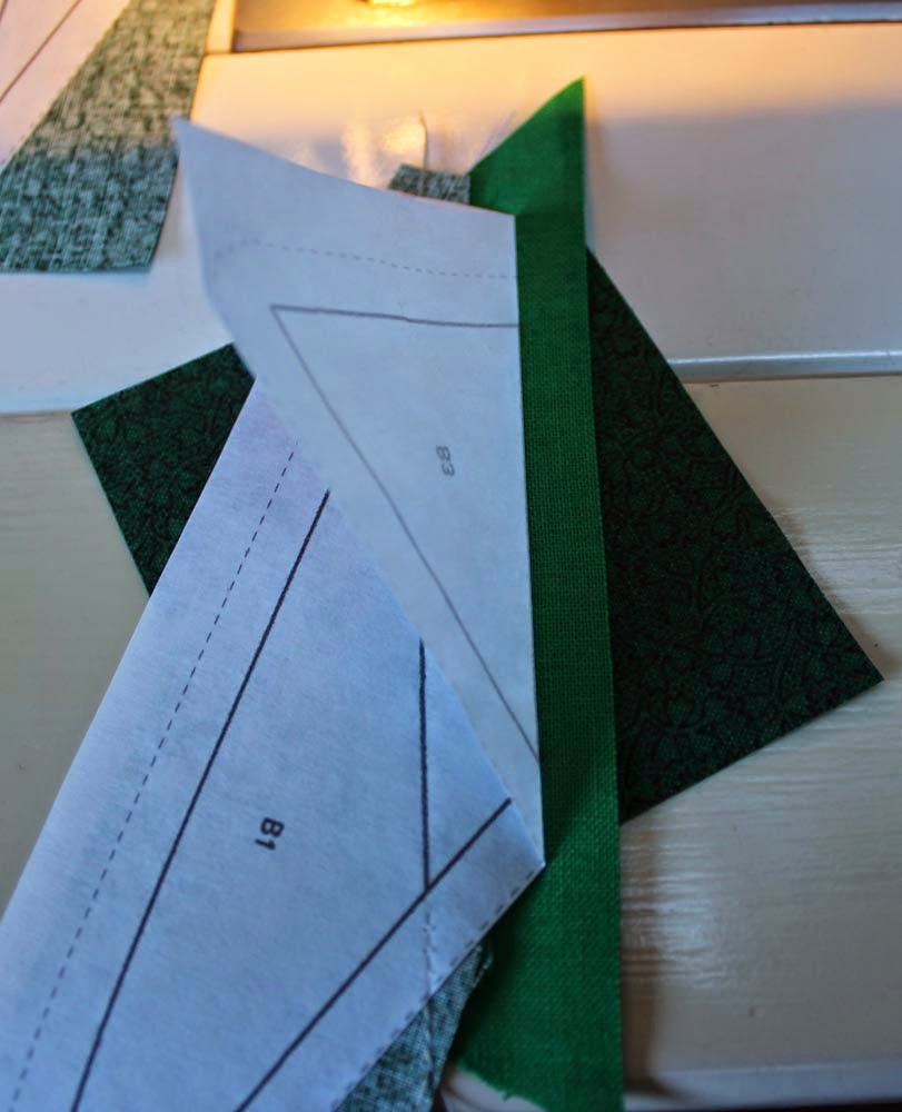 stitching along the paper edge in freezer paper piecing