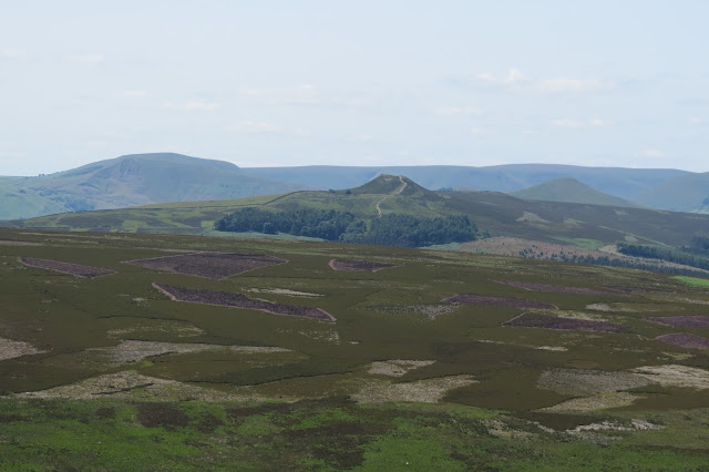 Across moorland, Winhill Pike in the centre. Behind it on either side, the summits of Mam Tor and Lose Hill.