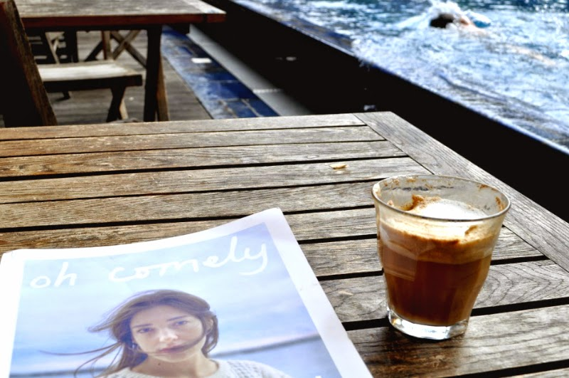 Oh comely magazine and coffee by the pool style in your city