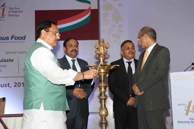 Lighting of the Lamp - Shri J P Nadda, Honourable Union Minister of Health & Family Welfare,  Shri C K Mishra, Secretary, Ministry of Health & Family Welfare, Shri Pawan Agarwal, CEO, Food Safety & Standards Authority of India(FSSAI), Shri Ashish Bahuguna, Chairperson, FSSAI