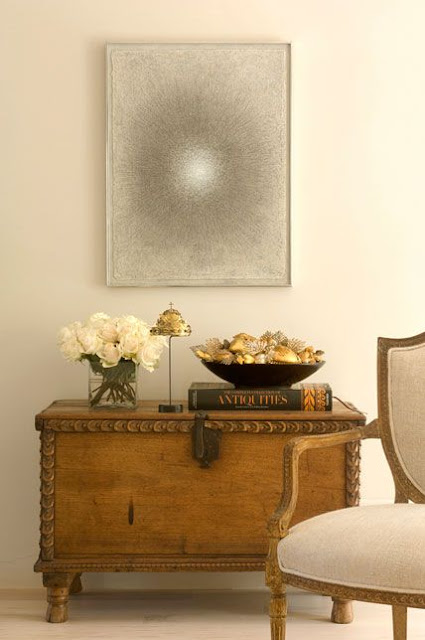 Elegant antique trunk and sophisticated design vignette by Peter Vitale