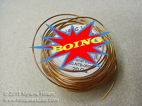 Wire spool that has sprung open and unravelled.