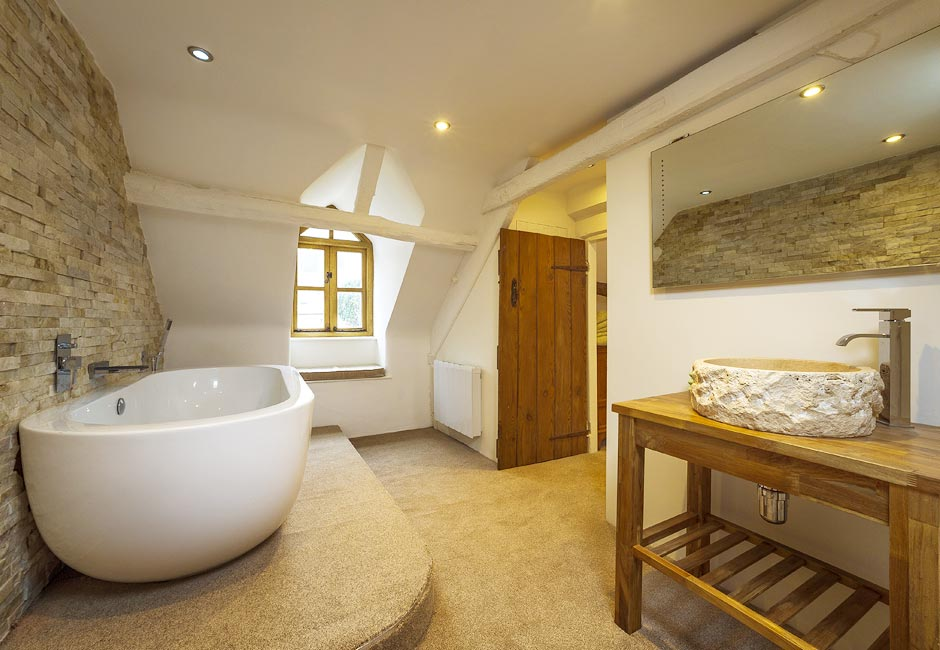 Modern stone bathroom - A Joyful Cottage 10 Real Cottage Bathrooms