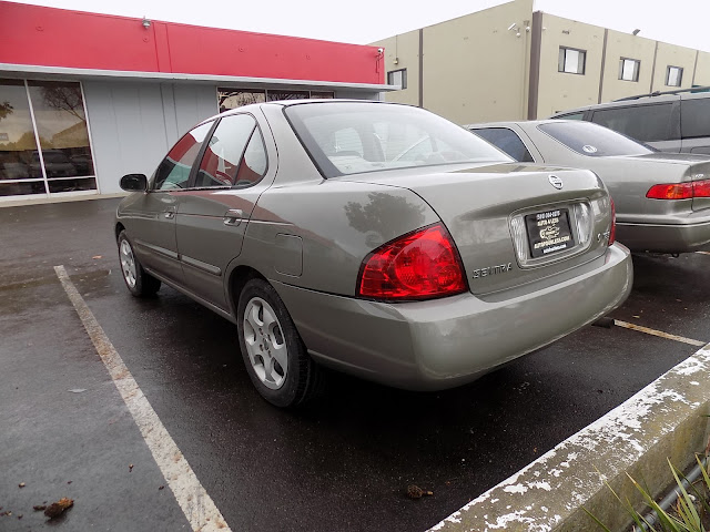 2004 Nissan Sentra with overall paint job from Almost Everything Auto Body.