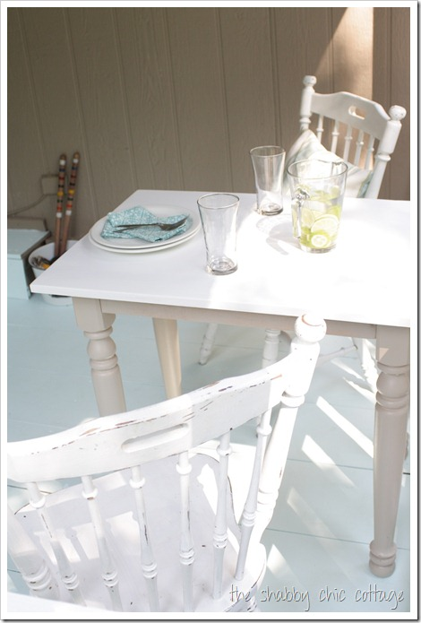 This friendly little side table is the perfect place for a refreshing treat on this porch