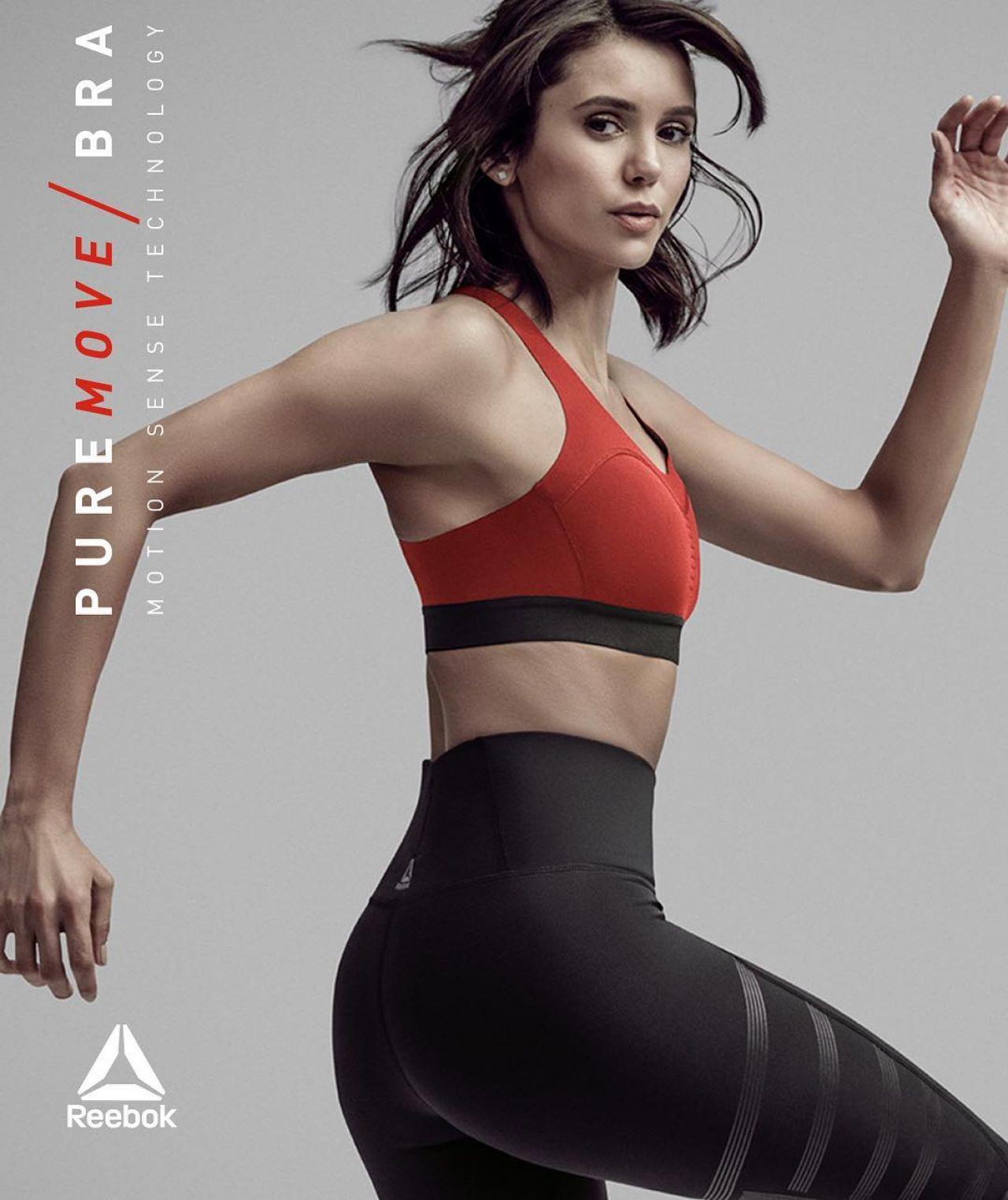 d74ce694cd18a0 Nina Dobrev is sexy in red Reebok sports bra