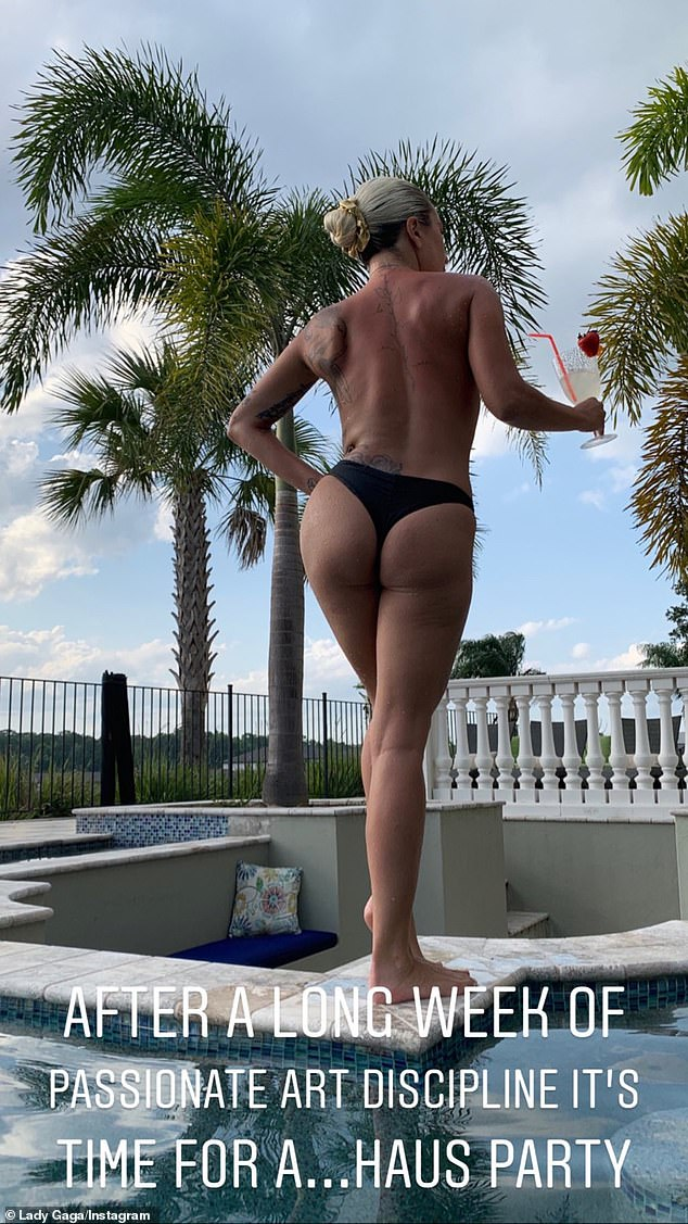 Lady Gaga stripped down to her thong to enjoy a poolside cocktail in Florida