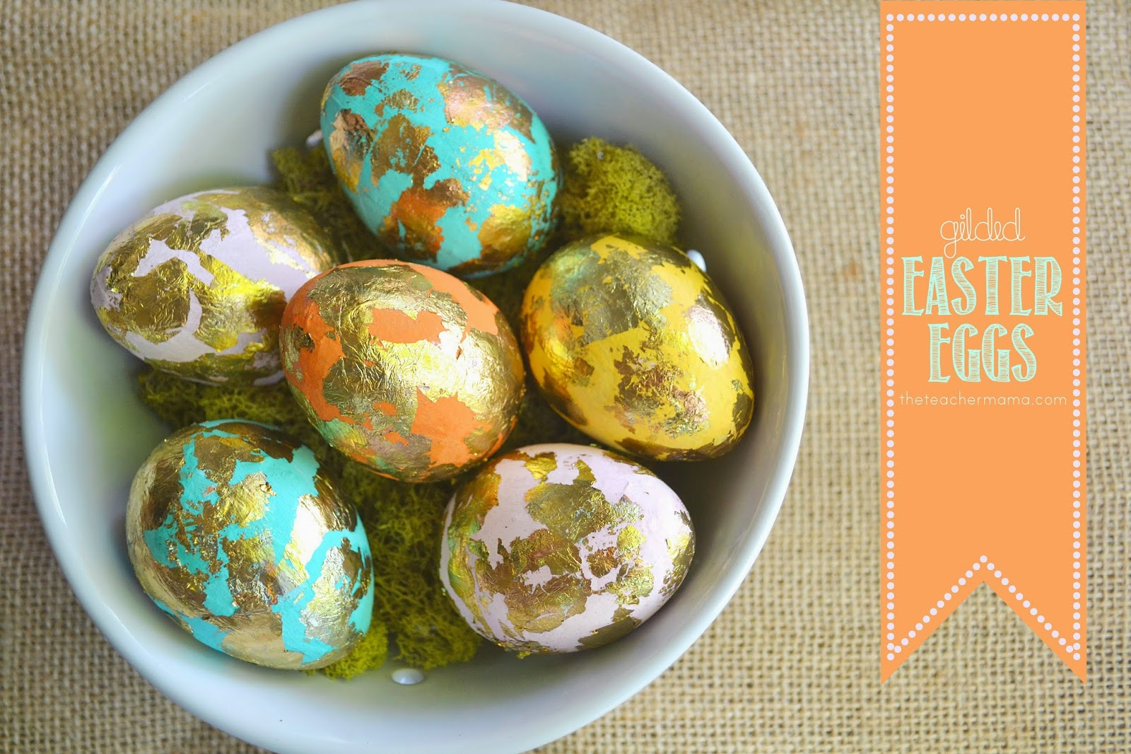 Gold gilded Easter eggs in a white bowl.