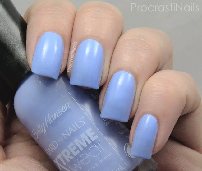 Swatch of Sally Hansen Babe Blue which is a baby blue nail polish