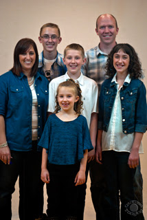 Portrait of a family in blue professionally done by Cramer Imaging in Pocatello, Bannock, Idaho