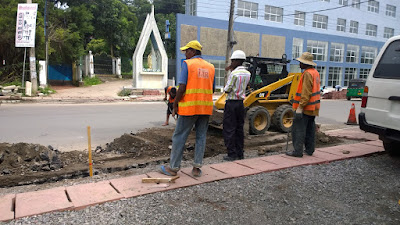 road workers working near pedestrian walking battaramulla