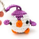 http://www.ravelry.com/patterns/library/mini-penguin-amigurumi-keychain