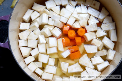 Recipe for comfort food side dish of carrots, celeriac, and potatoes simply simmered and mashed with butter and cream.