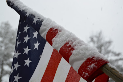 There's just something so American about snow on a flag.