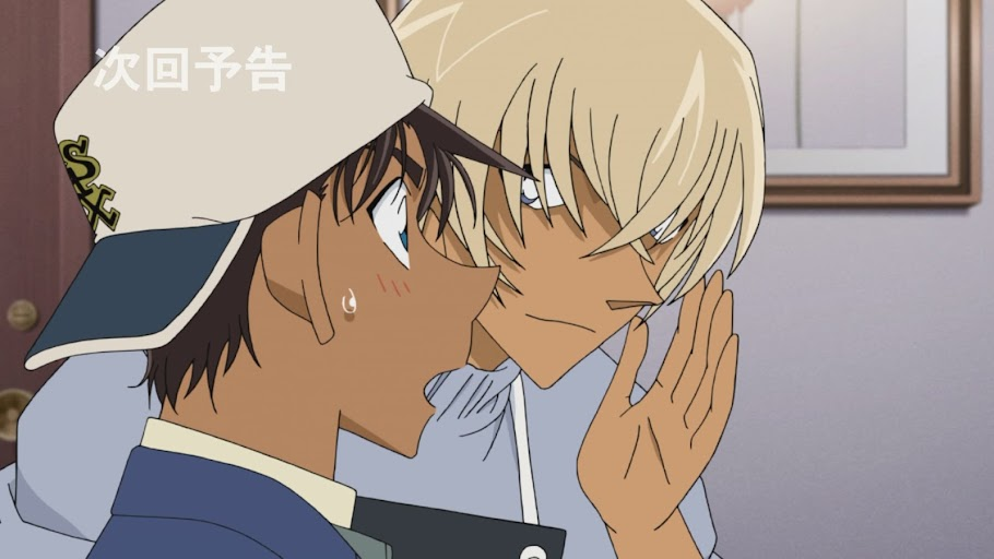 Amuro whispers to a surprised Heiji