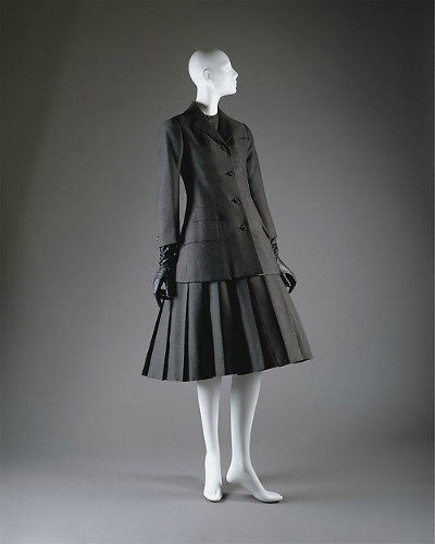 Black 1955 Dior suit dress displayed on mannequin
