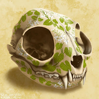 Cat skull decorated with wasabi leaves and flower