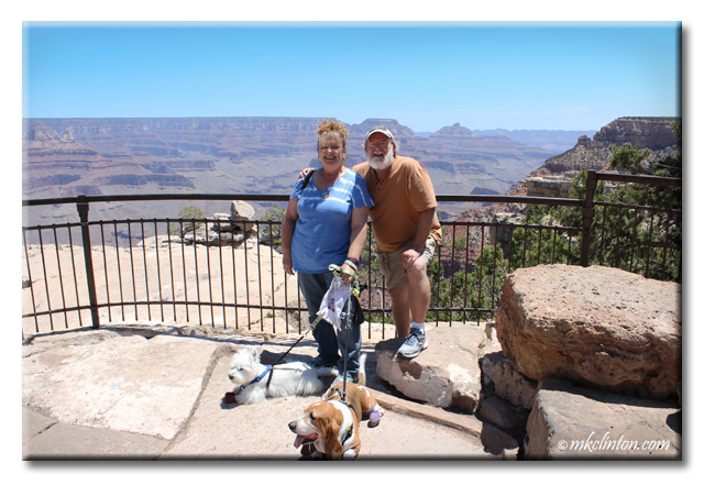 Man and wife with Basset and Westie dogs at Grand Canyon