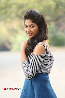 Telugu Actress Roshini Prakash Stills Short Dress at Saptagiri Express Release Press Meet  0045.JPG