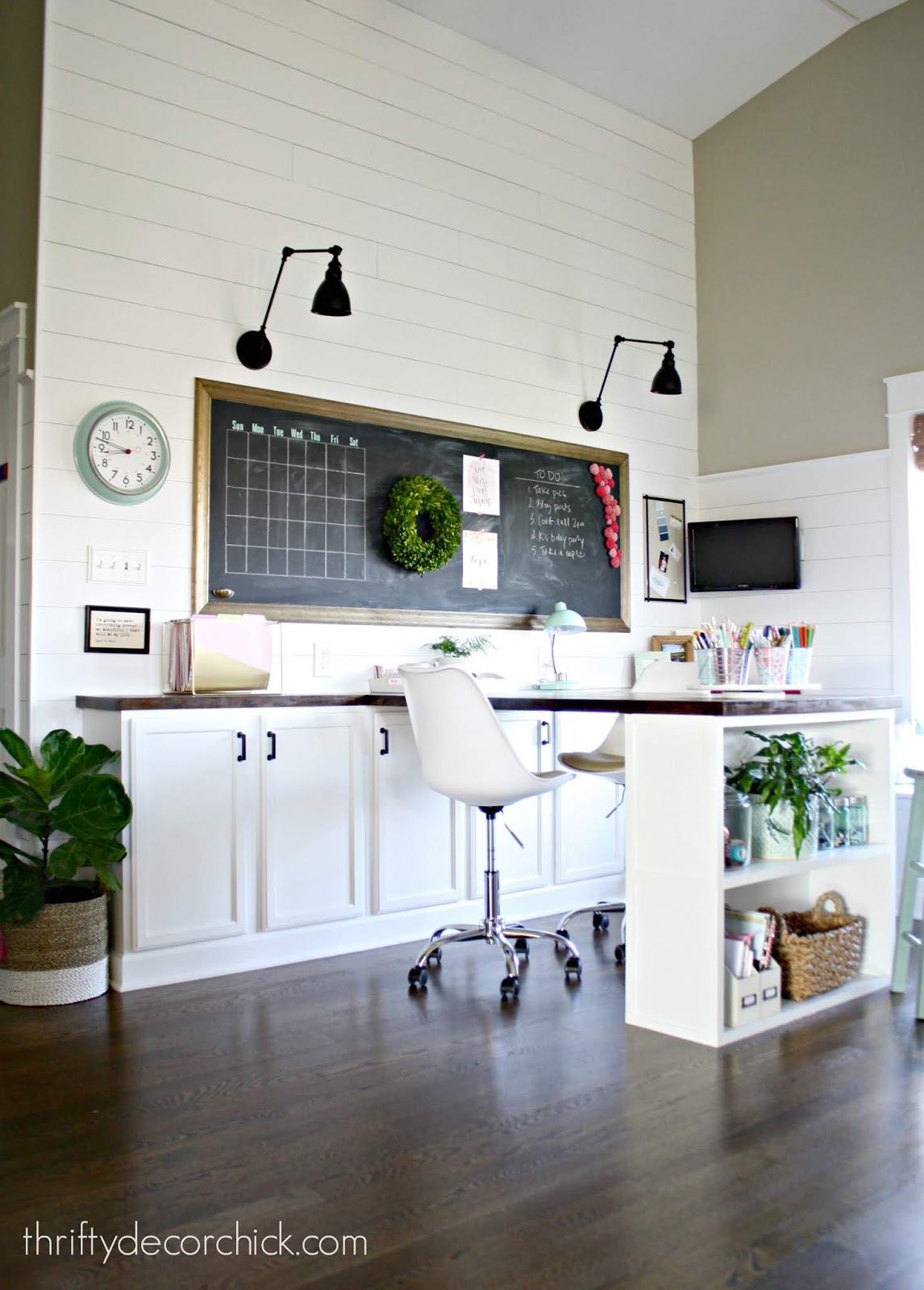 Farmhouse style office with shiplap and large desk with cabinets
