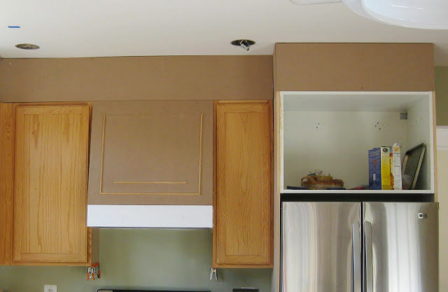 oak builder's grade kitchen with closed space above cabinets