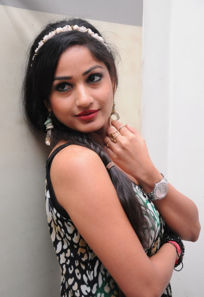 Madhavi latha at an audio launch looking cute