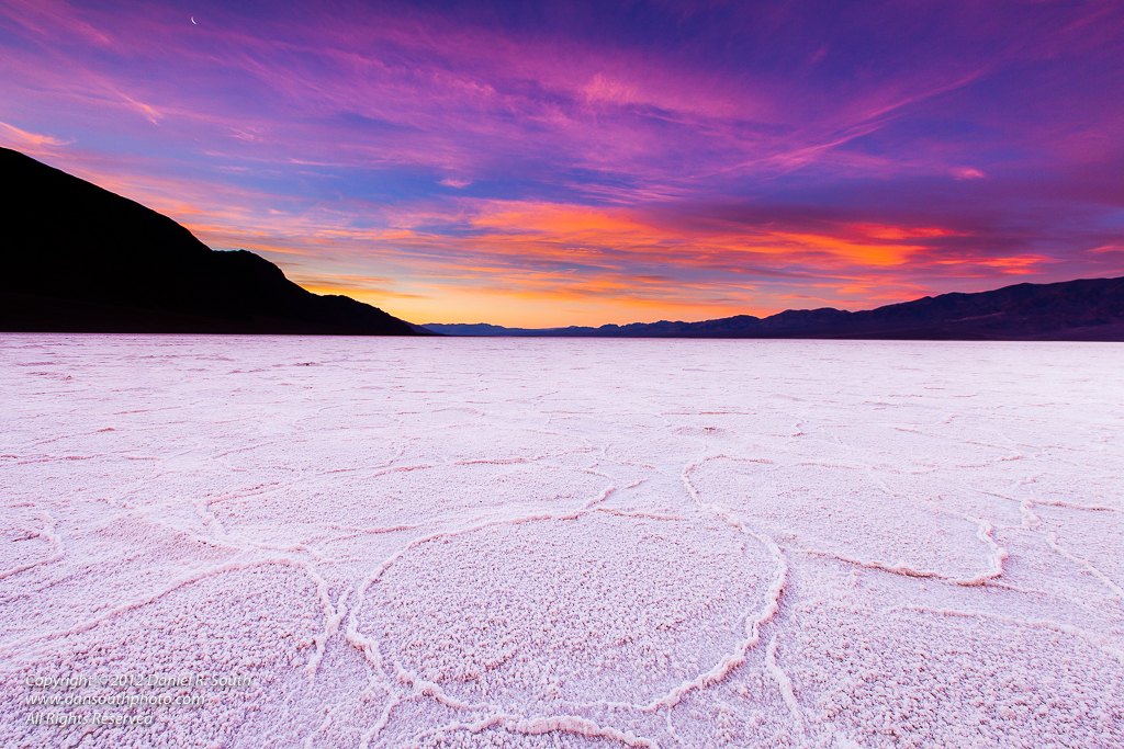 a photo of Sunrise and a Crescent Moon, Badwater, Death Valley