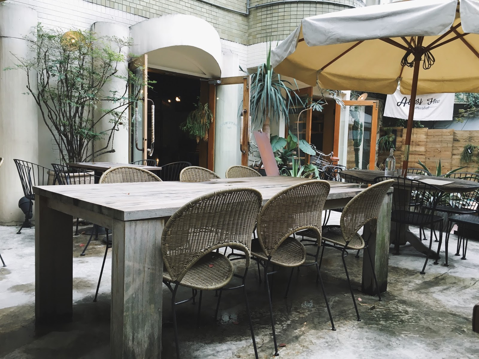 this cafe has a beautifully designed inviting rustic space also a very distinctive outdoor patio it is a nice place to sit and relax