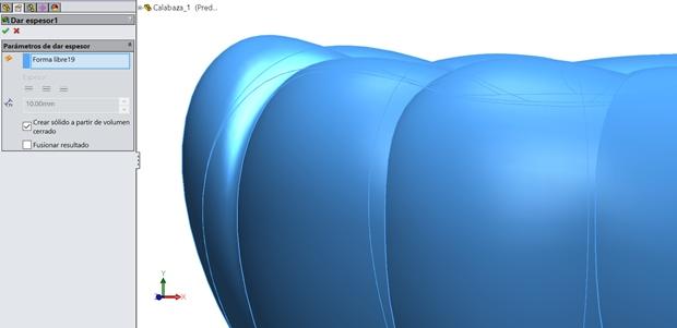 Utilización de la herramienta Dar espesor para convertir la superficie en solido