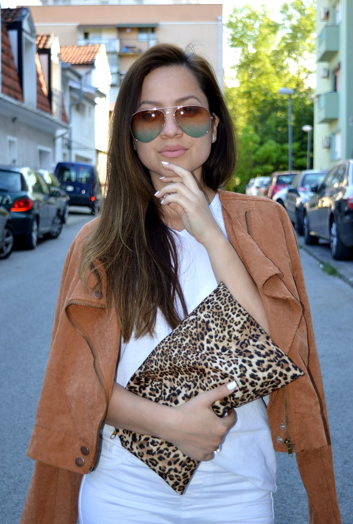 outfit, white pants, white t-shirt, brown faux suede jacket, brown faux suede lace up sandals, lace up sandals flats, gradient color sunglasses, leopard print clutch bag