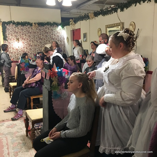 ladies get braids at The Great Dickens Christmas Fair in San Francisco
