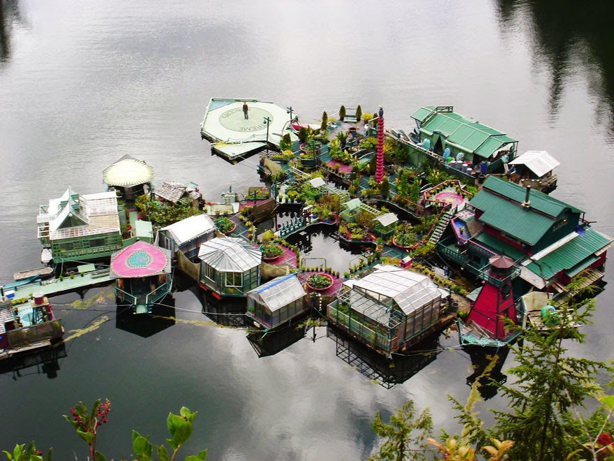 The constantly evolving off-the-grid floating home includes an art gallery, a studio, a dance floor, and 5 greenhouses - Couple Spends 20 Years Building A Self-Sustaining, Floating Island To Live Off The Grid