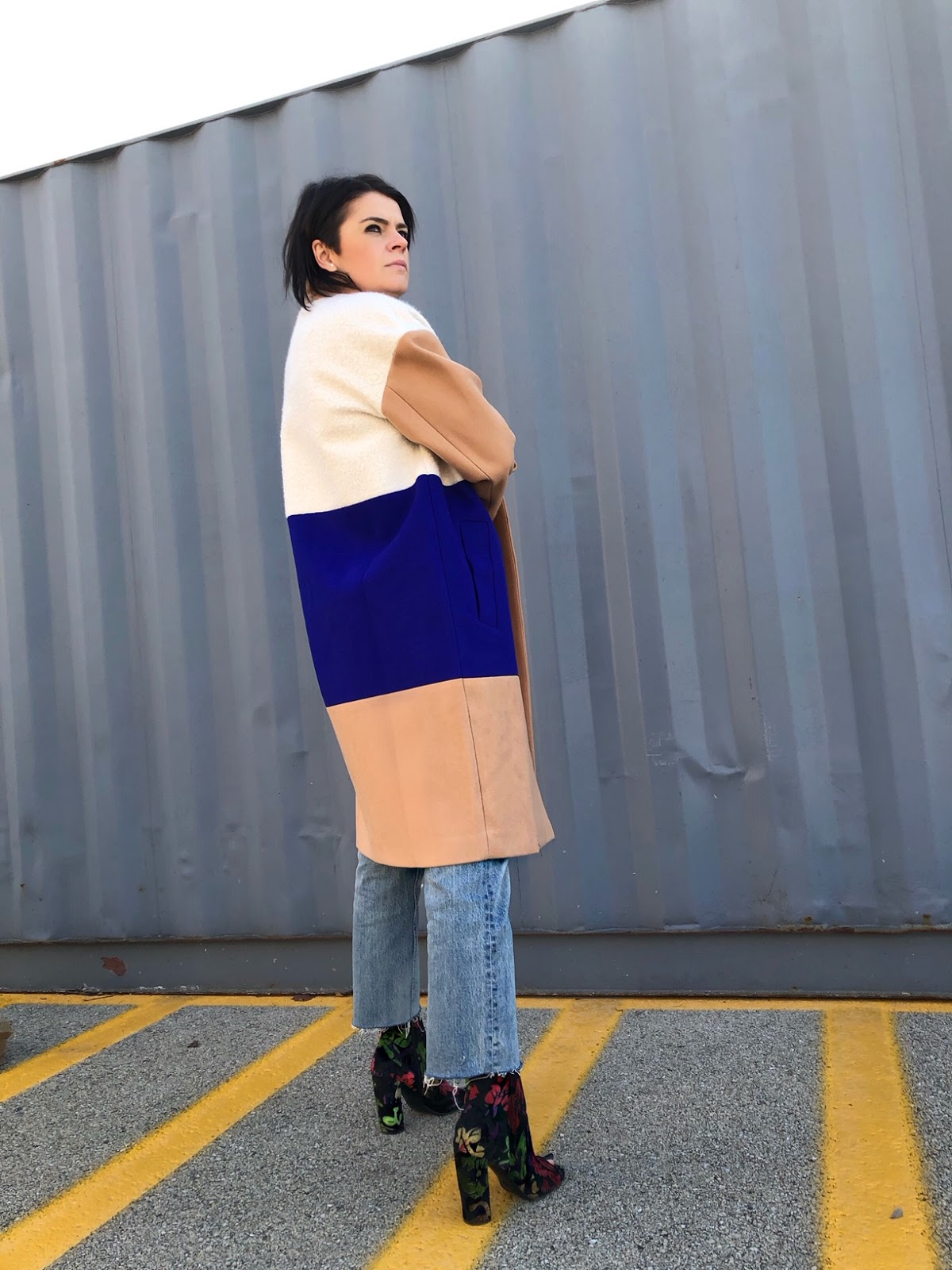 how to style a camel coat with navy and white color block detail