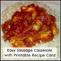 A plate of cooked sausage casserole on a bed of rice.