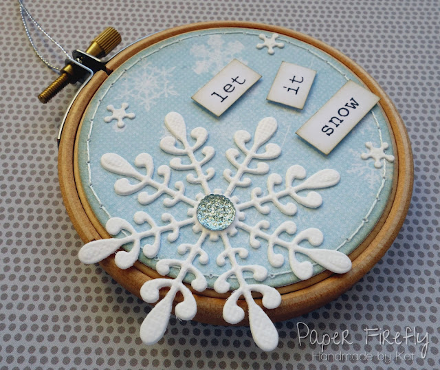 Snowflake decorated embroidery hoop