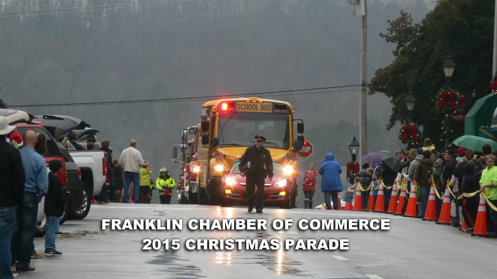 Franklin Police Chief David Adams leads the 2015 Christmas Parade down Main Street