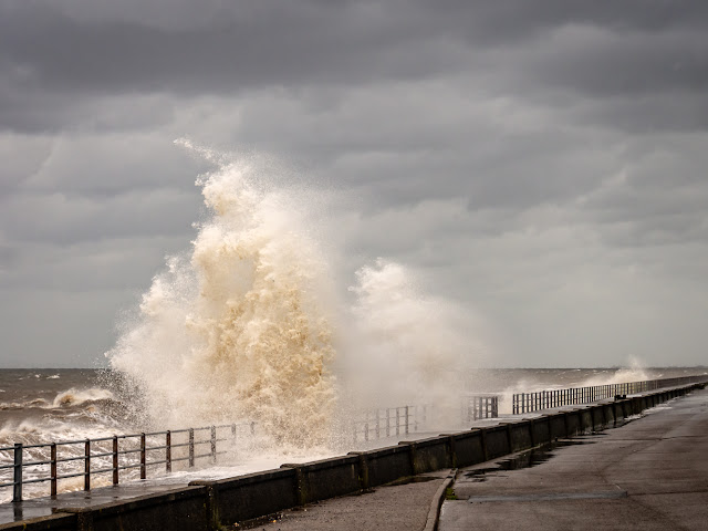 Photo of a giant wave smashing against Maryport Promenade at the tail end of Storm Hector