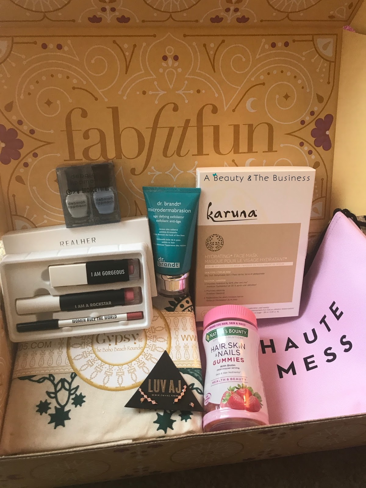 a beauty and the business, fabitfun box, spring fabfitfun box, unboxing, gypsy roundie, Briogeo Rosarco, real her, karuna hydrating mask, subscription box, luv aj, luv aj ear crawlers, siamese kitten, tortie siamese kitten, torties seal point siamese kitten, dr brandt microdermabrasion age defying exfoliator, leave in conditioning spray, milly zip pouch, debroah lippman, realher costmetics, realher lip kit, karuna hydrating face mask, skin care gummies biotin gummies, vitamin gummies