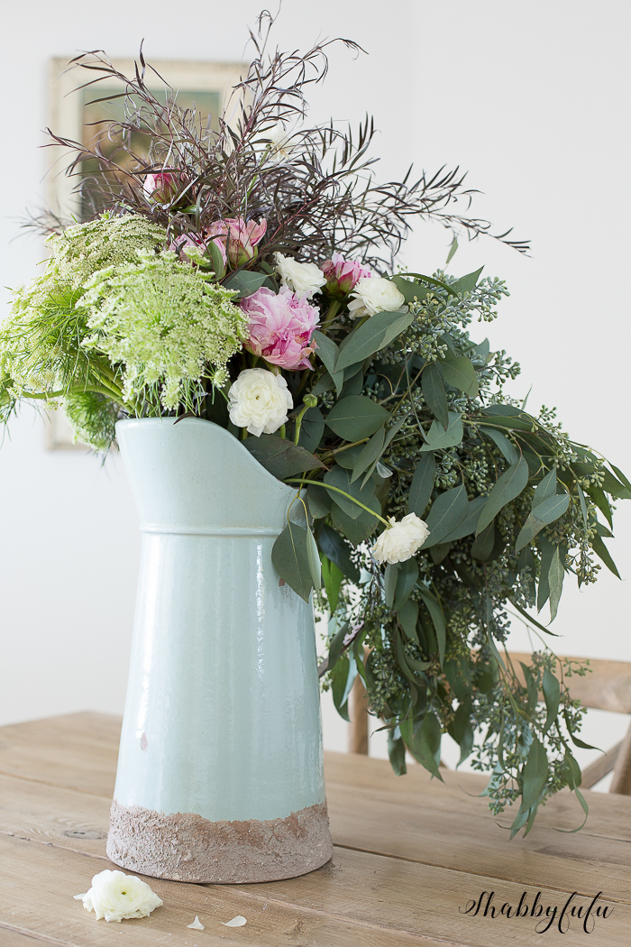 wild flower arrangement in a blue pitcher
