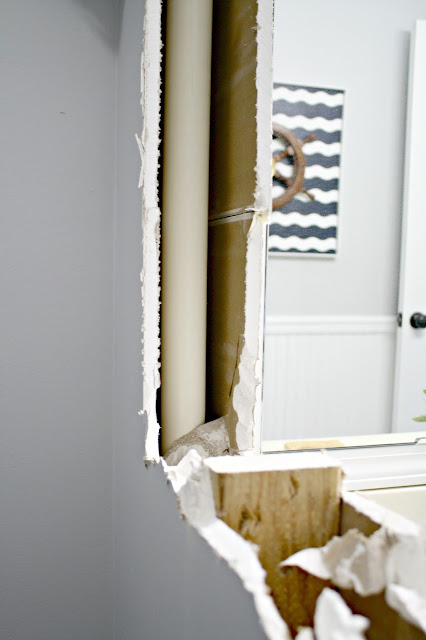 How to deal with vent in bathroom wall