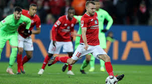 Daniel Brosinski's 86th-minute penalty saved a dramatic 1-1 draw for Mainz.