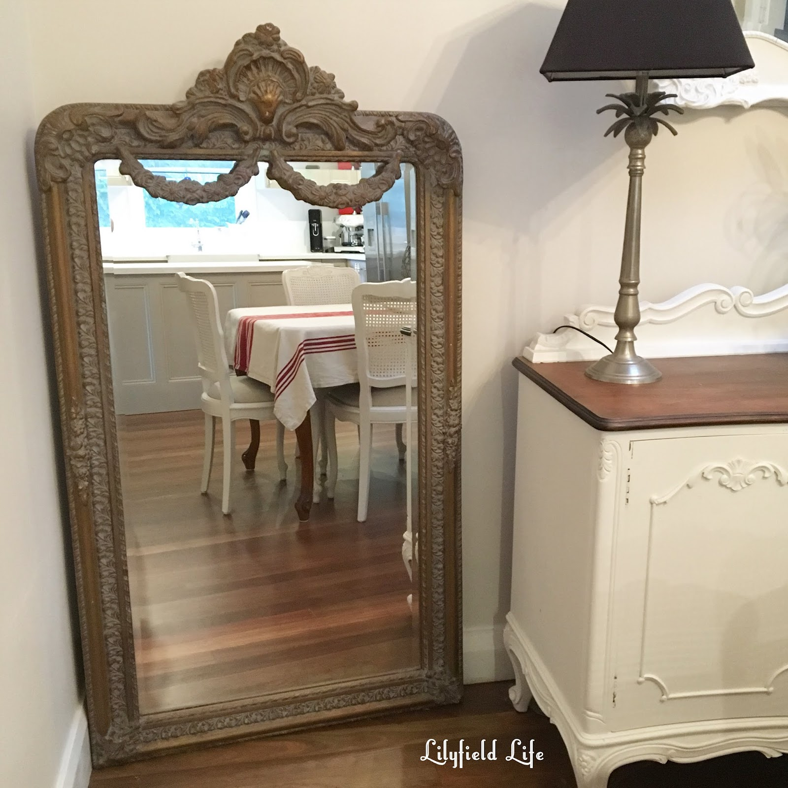 Ideal It us an antique french mirror and I am in love with it I have plans to hang it in our upstairs hallway in the meantime it can sit in the corner of my