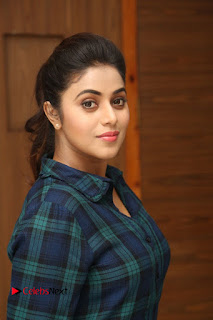Actress Poorna Stills in Denim Jeans at Jayammu Nischayammu Raa Movie Interview 0030