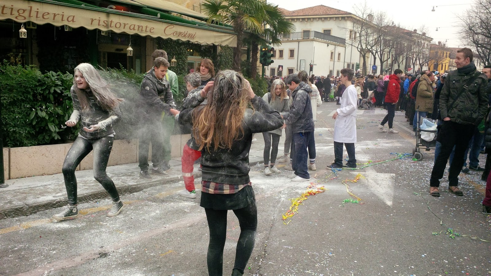 Teenagers throwing flour at each other, Verona Carnival 2015, Verona, Veneto, Italy