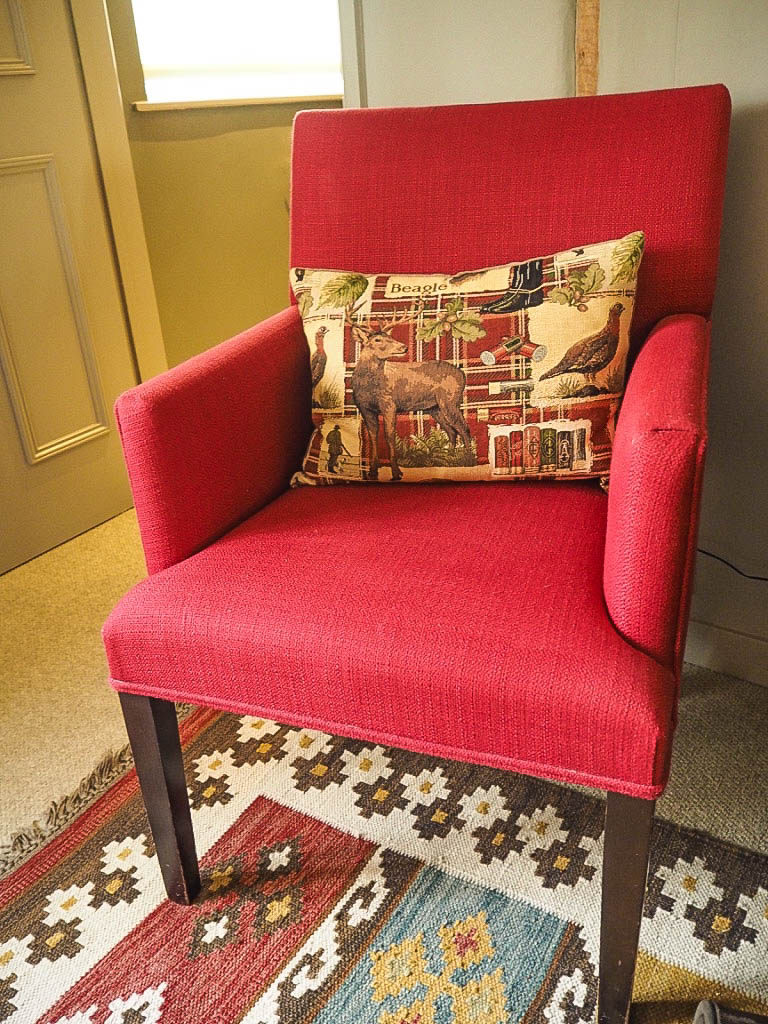 red armchair and cushion