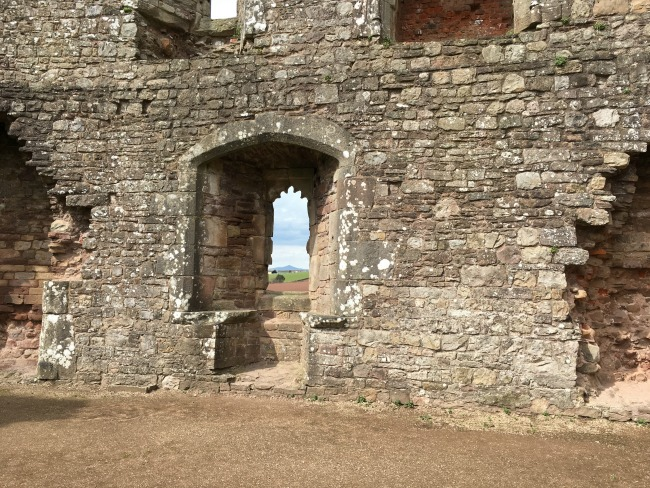 Raglan Castle - view of sugar loaf through a window